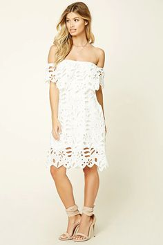 A woven dress by Haute Rogue™ featuring an off-the-shoulder design, floral crochet overlay, and a scalloped hem.