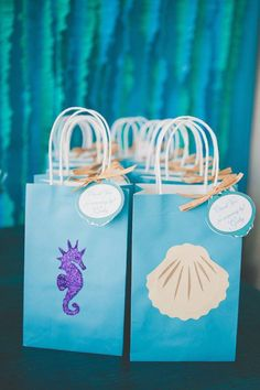 An Under the Sea Birthday Party with chocolate seashells, clamshell cookies, DIY lantern jellyfish, floral coral reef centerpieces + a starfish topped sea pebble & fish scales cake Mermaid Theme Birthday, Little Mermaid Birthday, Little Mermaid Parties, Mermaid Birthday Party Decorations Diy, Beach Party Favors, Mermaid Party Favors, Party Favours, Party Bags, Shower Favors