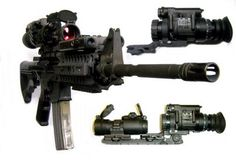 M4 with Aim-Point sight and PVS 14 Night Vision w/ red or green lazer pointer.