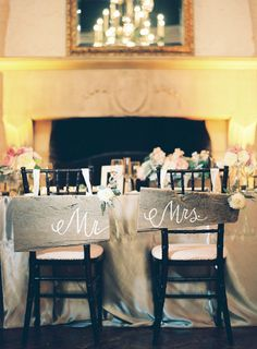 "If you're avoiding the traditional head table, these adorbs ""Mr & Mrs"" chair signs are a great option"