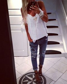 Casual white shirt and worn skinny jeans with sexy shoes.
