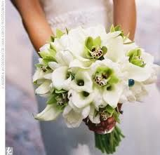 green orchids white mini calla lilies needs some dk greenery, baby's breath...