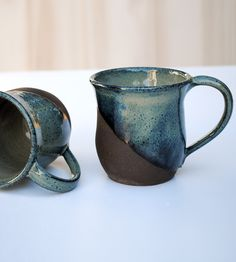 Handmade clay mugs for contemplative sipping, dip glazed on the outside to highlight the brilliant blue.