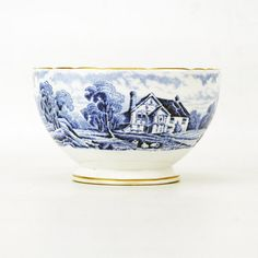 A 1950 H&M Ltd bone china bowl , probably originally for sugar, transfer printed in the delightful blue and white rural scenes pattern. The bowl has a gilt rim and edge to the foot and a further gilt band within. The base carries the H&M back stamp the letters flanking a rampant lion and words underneath reading made in England, Sutherland china, and bone china. The bowl is in good order throughout and measures 105 mm (4.25 inches) in diameter and stands 65 mm (2.5 inches) tall. Made by…
