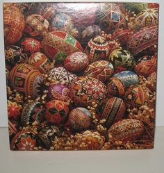 This Springbok jigsaw puzzle features lovely hand painted eggs by Dee Sullivan. #eastereggs #springbok