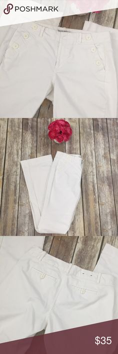 """Banana Republic Sailor Nautical Martin Fit Pants White Banana Republic sailor nautical style wide leg Pants. Martin Fit style. Size 6. Made of 98% cotton and 2% spandex. Very good condition with no flaws. Approximate measurements flat and unstretched: waist across back only 15.25"""", rise 8.5"""", inseam 32"""", leg opening 8.5"""". ⚓️No trades or holds. I negotiate only through the offer button. Any measurements listed are approximate since I am not a seamstress. 🚭🐩HB Banana Republic Pants Wide Leg"""