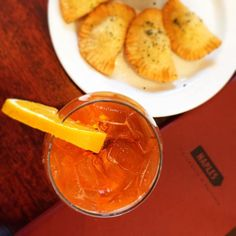 Refresh your thirst with a Aperol Spritz @naples_ristorante! It's Campari & prosecco. #foodielife