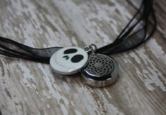 Essential Oil Diffuser Necklace- Aromatherapy Necklace- Stainless Steel Diffuser- Organza Diffuser Choker- Skeleton Diffuser Necklace Choker- Lotus Diffuser 20mm  Would you love to have your favorite essential oils diffusing right under your nose? My essential oil diffuser necklaces allow you to have just that! This adjustable choker style necklace features a small lotus diffuser locket with an enamel skeleton charm, on a black organza ribbon necklace.  All of the pieces used to create this…