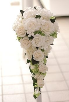 cascading rose bouquet..a little stiff looking but pretty never the less