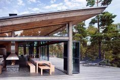 JOARC I ARCHITECTS • Holiday Villas • scandinavian summerhouse, lake house, mökki, folding sliding glass doors, finland, timber soffit