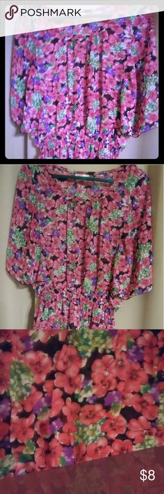 Pink Floral Top This is a floral half sleeve top made by Casual Land  The size of this top is Xl made from 100% Polyester. Casual Land Tops Tees - Short Sleeve