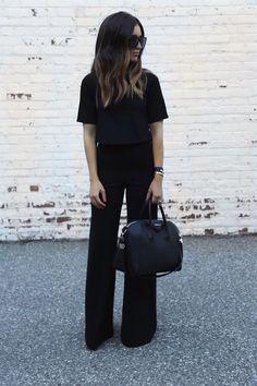 10 Ideias de produções all black para investir no trabalho. Blusa preta, calça pantalona preta