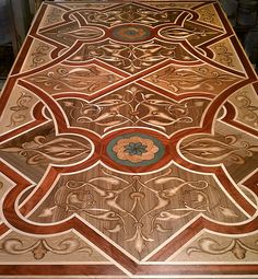 "Wood Floor Medallions | All ""vine"" elements are relief carved with natural burn color for ..."