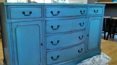 Custom painted buffet. Turquoise with brown glaze, subtle bronze metallic on carved detail