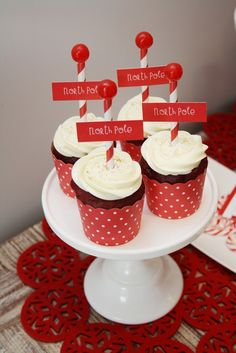 Cute cupcakes at a Red and White Christmas party.   See more party ideas at CatchMyParty.com.  #christmaspartyideas