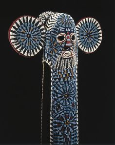 Unknown Bamileke Artist, Kuosi Society Elephant Mask, Place made: Grassfields region Cameroon, 20th century, Cloth, beads, raffia, fiber, Overall: 144.1 x 54.6cm, Other: 144.1 x 54.6cm, Purchased with funds given by Mr. and Mrs. Milton F. Rosenthal, Brooklyn Museum Collection.