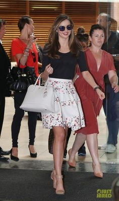 Miranda Kerr wearing Mcs Elena 14k Bracelet, Miu Miu Fall 2011 Cat Eye Sunglasses, Prada Saffiano Top-Handle Bag, Bvlgari Watch, Bvlgari Serpenti Bracelet, Christian Dior Cruise 2013 Skirt and Alexander Wang Liya Ankle Strap Pumps.