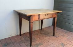 A Cape Yellowwood and Stinkwood Peg Top Table, early 19th c. (sold)