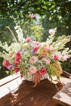 pink wildflower bouquet by Petals & Hedges