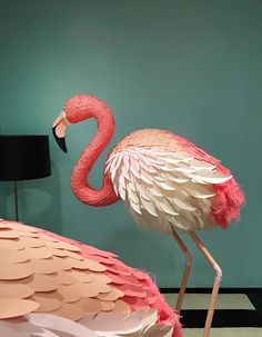 I love the use of paper and feathers together. Kate Spade NY Showroom Flamingos on Behance