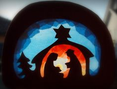 Christmas nativity (looks to me to be made of colored tissue paper and black construction paper - very nice).