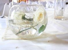 Centerpiece like the two flowers and the gems at the bottom with the gold curl