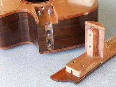 Trevor Gore Guitars - Innovation: Bolt-on acoustic neck joint with truss-rod accessible form within the body cavity
