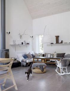 scandinavian living room. neutrals, fireplace.