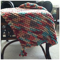 PomPom Cuddle Blanket - free Ravelry download We don't get this wool here in India, but like it.