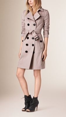Burberry Sandringham fit trench coat in Italian-woven cashmere. The unlined design is slim with a tapered waist and can be worn belted for a close fit or open and relaxed. Heritage details include a storm shield and check undercollar. Discover the women's outerwear collection at Burberry.com