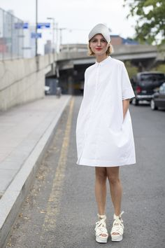 An oversized white shirt is your new favorite laidback spring dress as seen at NYFW on Vogue UK.