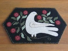This wool appliqued penny rug is so beautiful Nancy and Christina of Widgets & Wool Primitives!!!