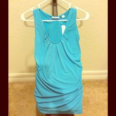 ⬇️ New York & Company Turquoise V-neck Top New with tags New York & Company Turquoise Sleeveless V-neck Top.  Size XS.  95% polyester.  5% spandex.  Great top for business casual wear.  Pretty color!  Great under blazer or open sweater! New York & Company Tops