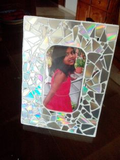 Best out of waste - a photo frame from thermacol packing material and cut up old CDs for a mirrorwork effect. New Crafts, Creative Crafts, Arts And Crafts, Diy Recycle, Recycling, Diy For Kids, Crafts For Kids, How To Make Photo, Craft From Waste Material