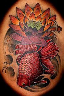 This is an amazing tattoo, beautiful!  kenya and lotus   Fr. catfishtattoos.blogspot.com