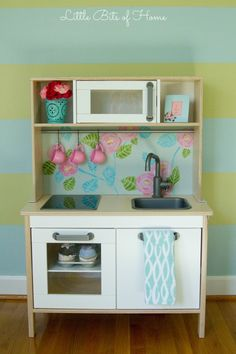 Little Bits of Home: Anthropologie Inspired Ikea Play Kitchen Hack Ikea Play Kitchen, Kitchen Hacks, Play Kitchens, Play Kitchen Accessories, Red Desk, Savvy Southern Style, Toy Rooms, Little Girl Rooms, Home Hacks