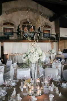 Tall floral arrangements for this ballroom wedding {Clint Bargen Photography}