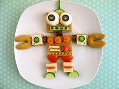 This adorable veggie robot will wow your picky eater. Play to their imagination with food! Cute Snacks, Cute Food, Good Food, Yummy Food, Food Art For Kids, Cooking With Kids, Kids Food Crafts, Toddler Meals, Kids Meals