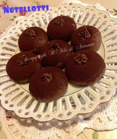 http://blog.cookaround.com/ilfilodiariannas/nutellotti-farciti-alla-nutella-2/
