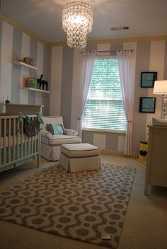 striped walls and chandelier - nursery