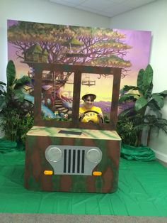 Our photo booth for Journey Off the Map. Jeep made from cardboard covering a small table