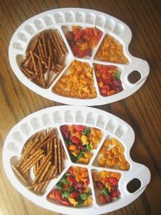 I used art palettes as serving trays for my daughter's Arts and Crafts Crayon theme celebration.   I purchased the art palettes at my local craft store and filled the trays with pretzel sticks and goldfish crackers.