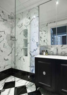 Glamorous bathroom by Greg Natale. Statuario/black marble. Love the black vanity.