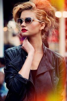 SHARON KAVJIAN for Wilhelmina Models. Beautiful HUGE hair, cat eye glasses, clean line leather jacket, RED lips. stunning.