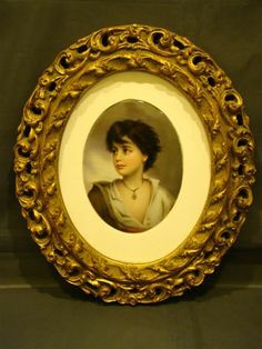 Porcelain hand painted portrait plaque of youth in gilt frame