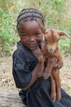 Zambia girl with her little goat