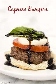 Caprese burgers are topped with the classic flavors of caprese — tomato, basil, mozzarella, and a balsamic reduction sauce.
