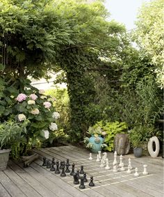 Bright idea: A few chalked lines can turn a deck into a game board for oversize chess pieces. Other fun ideas for lawn games? Croquet, bocce, cornhole, lawn darts, ladder toss—the list goes on and on!   - CountryLiving.com