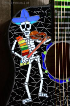 """Dia de los Muertos"". Stained glass mosaic on retired Fender acoustic-electric guitar. ©KACIE mosaics & art"