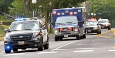 Moments after  Mendota Heights Police Officer Scott Patrick was shot and killed during a traffic stop, the ambulance, escorted by multiple police vehicles, was speeding north on Smith Avenue in St. Paul on Wednesday. Police confirmed the officer was shot at Dodd Road and Smith Avenue in West St. Paul.  (Pioneer Press: Ben Garvin)